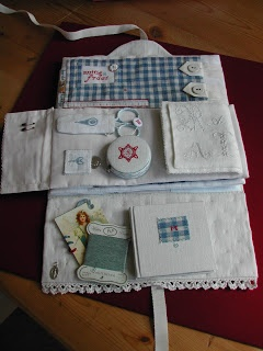 embroidery kit - like the felt needle pages used as a flap to keep things in pockets