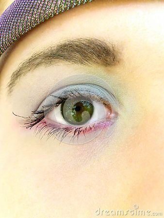 A close-up view of a teenage girl's eye with make-up on.