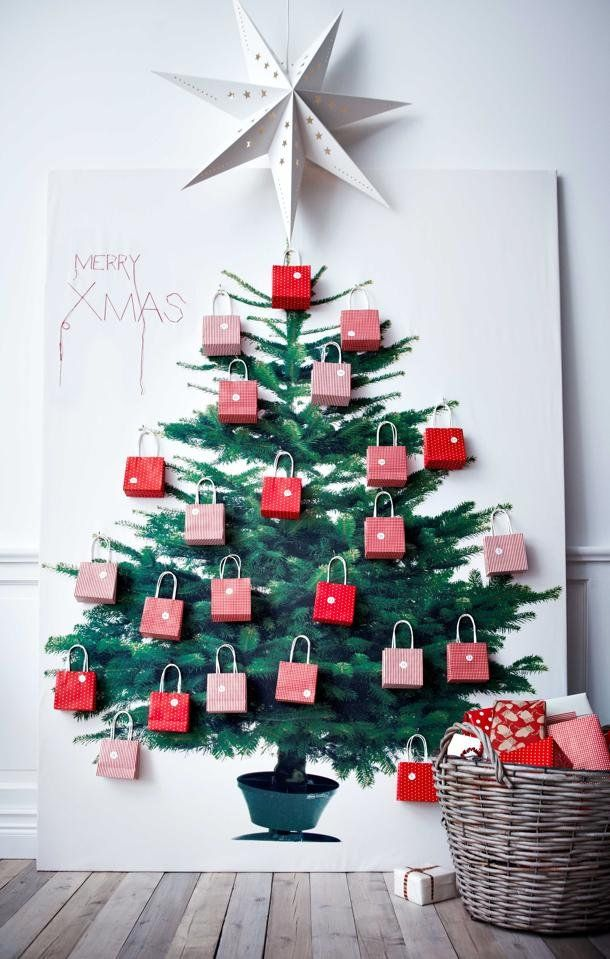 Space-saving Christmas tree alternatives. This one is fabric from IKEA, studded with little gift bags to make an Advent calendar.