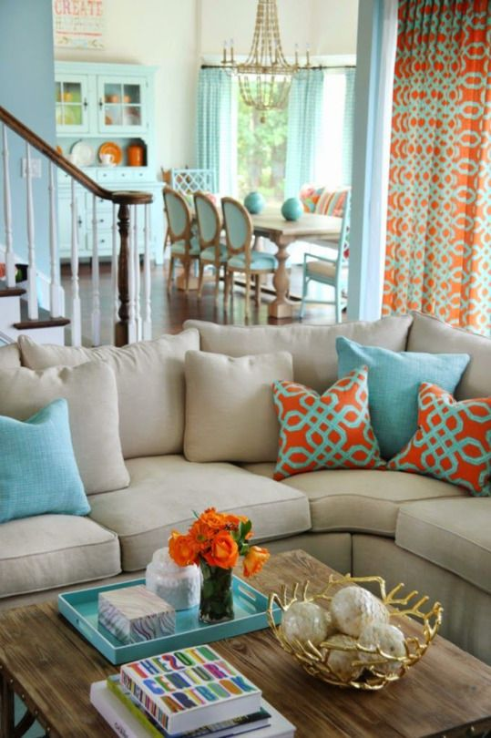 Turquoise and orange pops of color in a living room and dining room