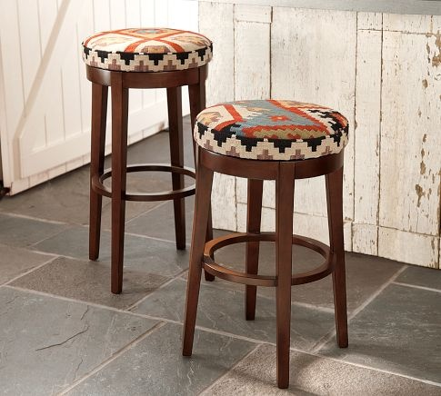 I want these! Kilim stools----could be with a neutral background with a touch of red to match my kitchen or a solid red tapestry
