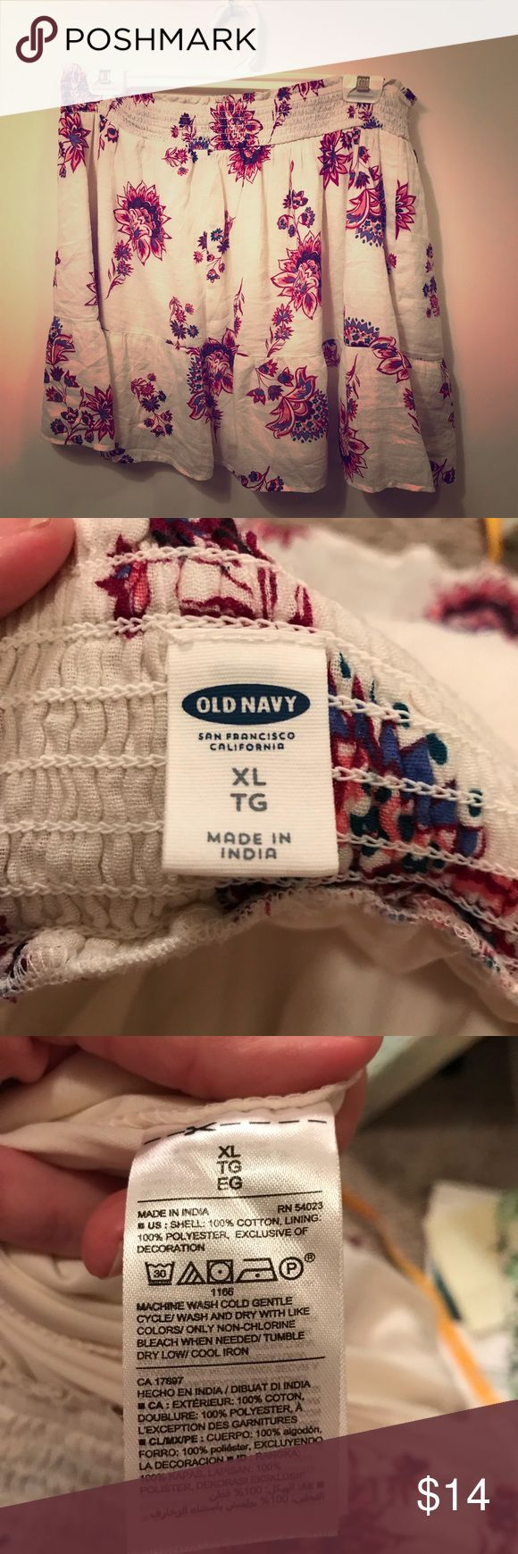 Smock-waist Circle Skirt White OLD NAVY Floral XL NWOT! Super cute summer/fall 2017, still in stores! 19.99 retail. Cream with burgundy flowers, 100% cotton, lined. Waist measures 37 inches wide with elastic so it could accommodate larger size waist and length is 19 inches. There is a soft ruffle at the bottom.  Made in India.  Please email me with questions Old Navy Skirts Mini