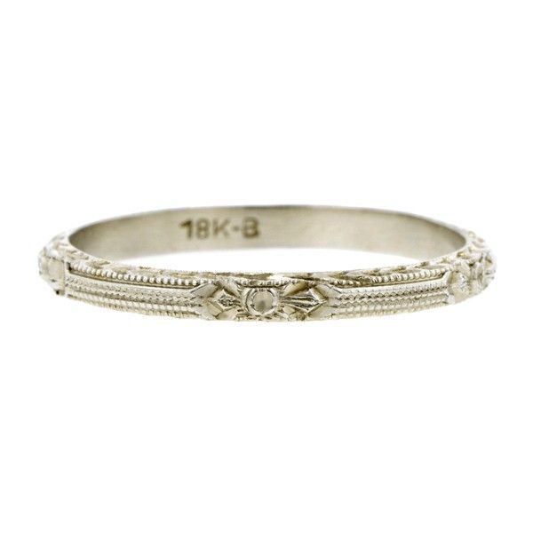 Vintage Patterned Wedding Band::measuring app. 2.0mm wide with alternating stylized flower and beaded rows design and engraved sides, fashioned in 18k white gold. Unidentified maker's mark. Circa1935. Size 6