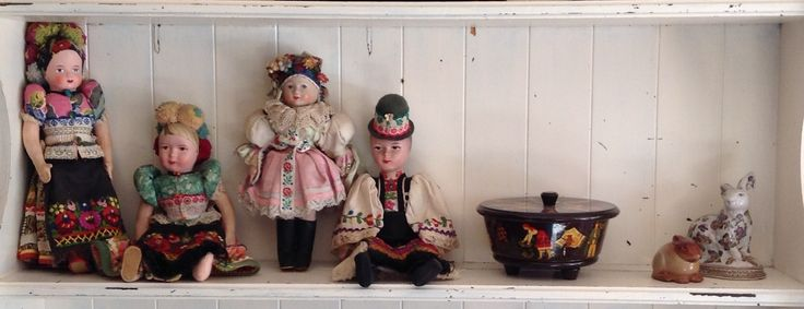 A shelf in the lounge room, with some of my favourite souvenirs from a trip to Paris. I love old costume dolls!