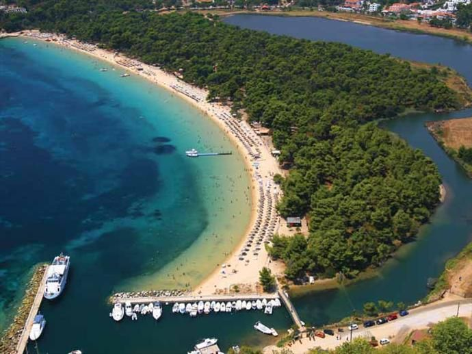 Koukanaris beach: This beach, set beyond the lagoon, is a one kilometer long arc of fine golden sand that is often rated as one of the best ten beaches in Greece.