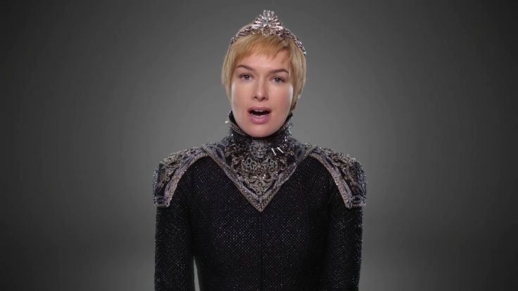 Further south, Queen Cersei is striking in her black gown with embroidered silver shoulder pads.