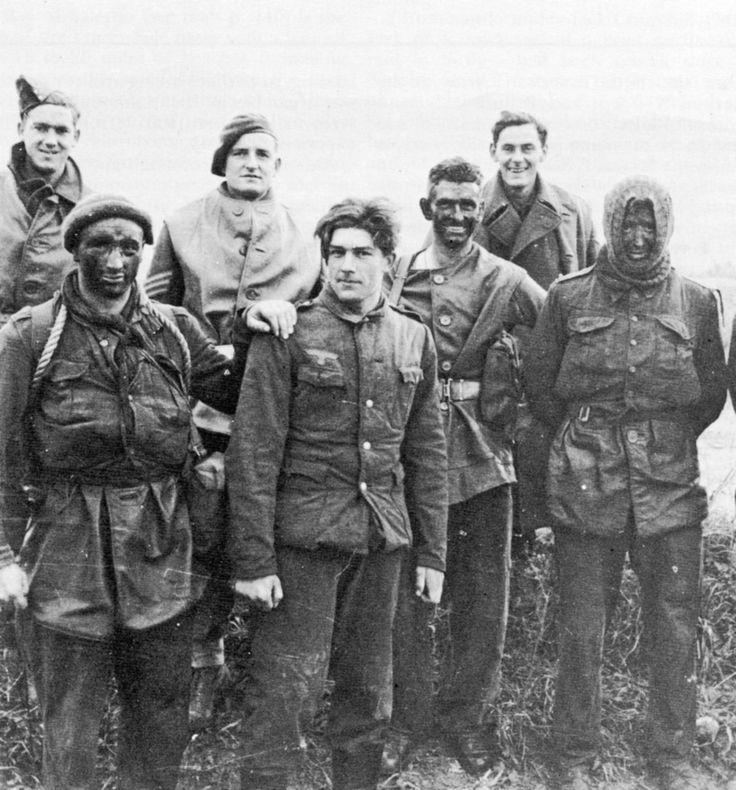 "Britishcommandoswith German prisoner, France, 1944    He looks sohappy.  ""I'm going to America! …ladies."""