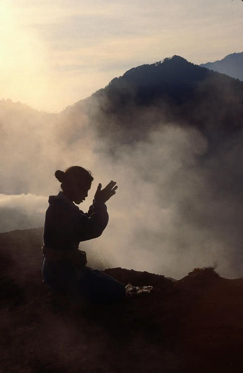 Woman leaving an offering on Mt. Batur - Bali, Indonesia