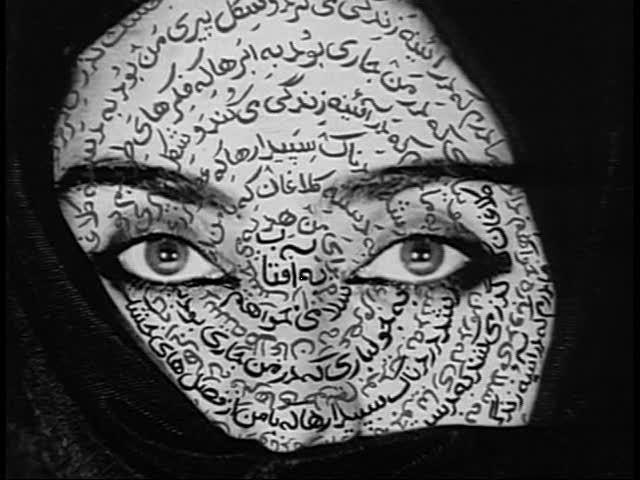 "Shirin Neshat, portrait in the Iranian Artist ""Women of Allah"" series. Most of the portraits in this series are of women with guns and provide a commentary on the Iran Iraq war. She uses painted calligraphy on the hands, feet and faces of the subject as a way to invite the viewer to think more deeply about the women. Where is this woman from? What do you think the words say? Would be interesting to read the translation? What do you think the women is feeling?"