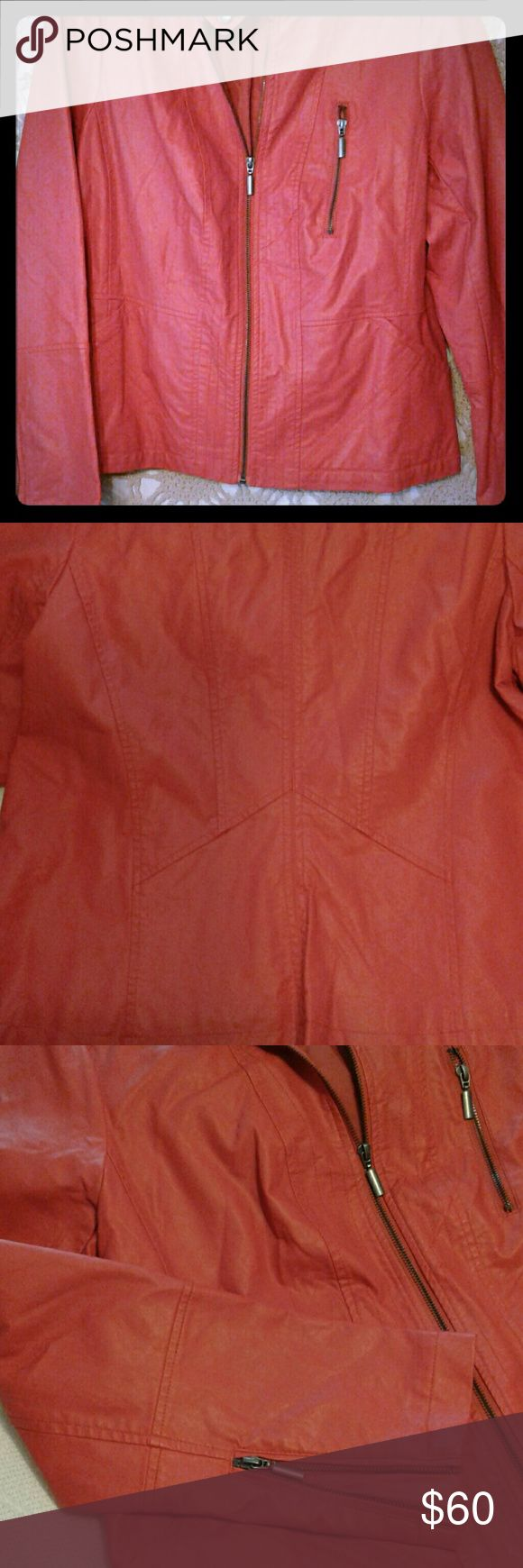 Susan Graver jacket Susan Graver orange jacket two large pockets on the front one zipper pocket on the chest zippers on the sleeve photos does not do this jacket Justice it's a beautiful Orange beautiful jacket overall in perfect condition like new Susan Graver Jackets & Coats