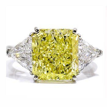 Canary Princess Trilogy Diamond Engagement Ring - This simple & beautiful Canary Princess Trilogy Diamond Engagement Ring is a tasteful combination of top-quality materials & minimal design. It contains 3 brilliant well cut diamonds of high color & clarity. A canary yellow center stone in a Princess cut is carefully set between two lovely matched triangle cut stones to bring out the best highlights of all three. The shank is made of solid, fully-hallmarked gold. #unusualengagementrings