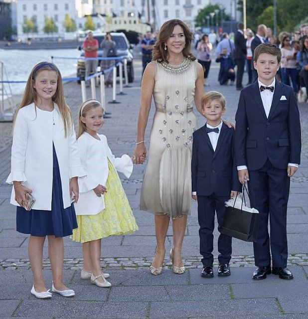 Crown Princess Mary looked elegant in a cream pleated dress, and was joined by her children from left to right Princess Isabella, Princess Josephine, Prince Vincent and Prince Christian of Denmark