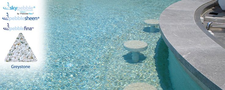 Natural inground pool with Skypebble®'s Greystone interior