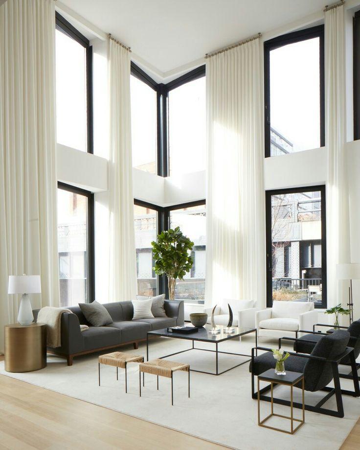 Soaring ceilings, white draperies and dark furnishings.