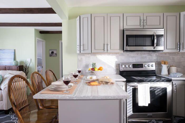 "Mark & Karen's Kitchen backsplash featuring our Start Series in Concrete Decor 10""x24"" http://olympiatile.com/product/series/760"