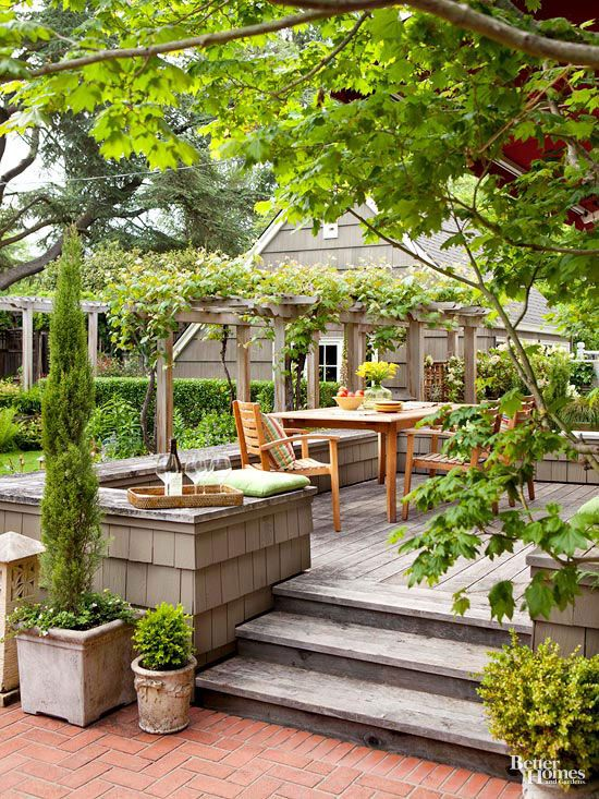 Green plantings serve as the artwork in this simple outdoor space. Find more ideas here: http://www.bhg.com/home-improvement/porch/outdoor-rooms/small-outdoor-living-spaces/?socsrc=bhgpin030815greenthumb&page=15