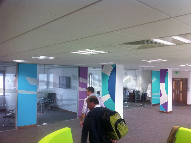 Funky Office Wall Graphics using bright colours on pillars
