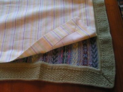 This blogger explains how she attached a fabric lining to the wrong side of the knit baby blanket she made.  (She's very precise and pays close attention to her finishing techniques.)