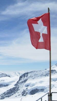 The Swiss flag from the top of Jungfrau Mountain in Switzerland.