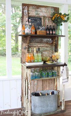 Warm Weather Outdoor Decorating Ideas - Finding Home. A beverage bar repurposing an old door. Sweet!