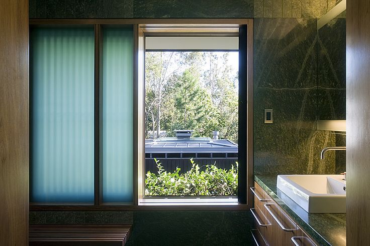 Samford House: Bathroom with framed views out to surrounding trees. See more at http://blighgraham.com.au/projects/samford-house-1