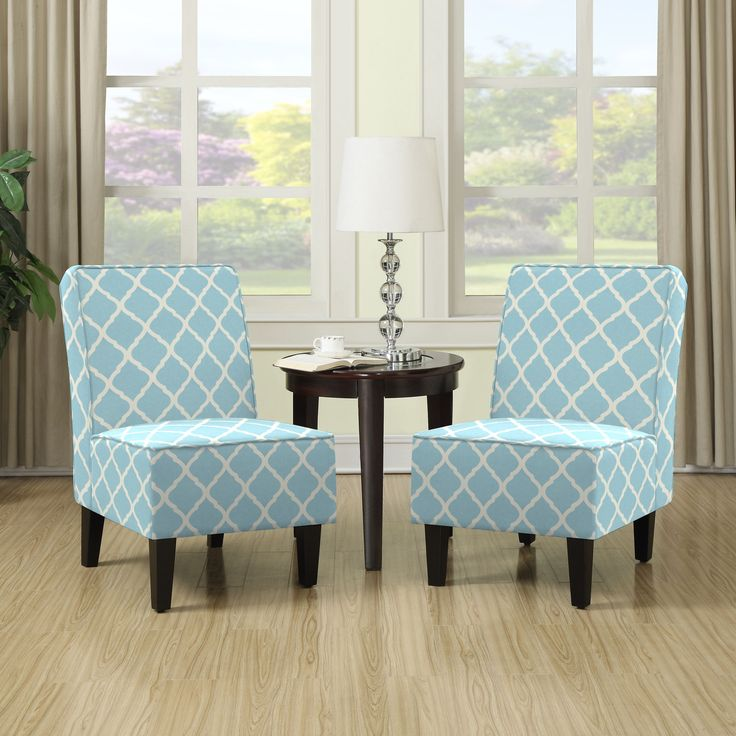 The Portfolio Wylie set of 2 armless chairs features upholstery in a turquoise blue and white fabric. These chairs are designed with a slightly contoured square back, no sag springs and thick deep seat foam cushioning for extraordinary comfort.