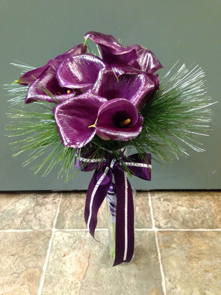 Simple and classic bouquet of deep purple calla lilies, with just enough sparkle and bling for a winter wonderland wedding.