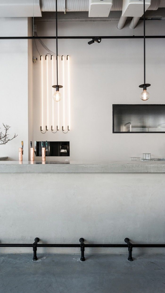 usine_interior_mikael axelsson modern contemporary minimal minimalist kitchen island grey black industrial copper built in sleek light bulbs clean style home decor concrete counter working top walls floor