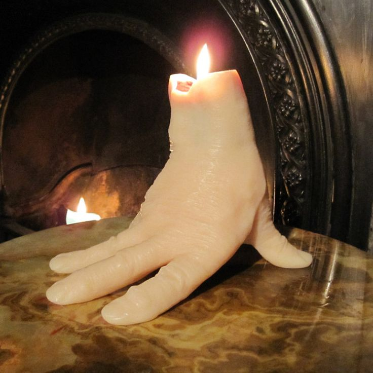 Hand-shaped Candle For Halloween. make your own version with a surgical glove.
