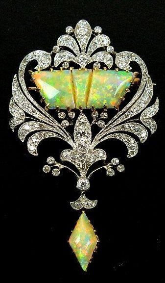 An early 20th century diamond and opal set brooch, designed as a three panel opa...