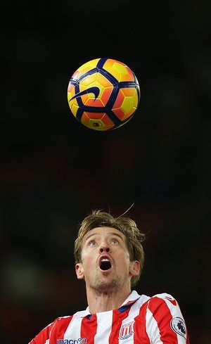 Peter Crouch watches the ball