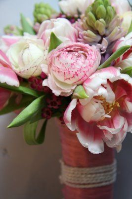 "A clustered bouquet of Pink Double Parrot Tulips ""Destiny"", Ranunculas, Hyacinths & Wax flower blossom."