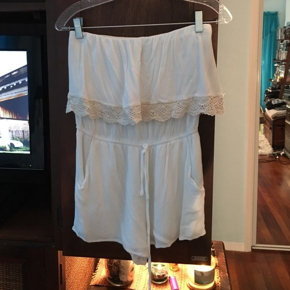 Forever 21 strapless romper Never been worn strapless romper with elastic draw string waist and pockets Forever 21 Pants Jumpsuits & Rompers