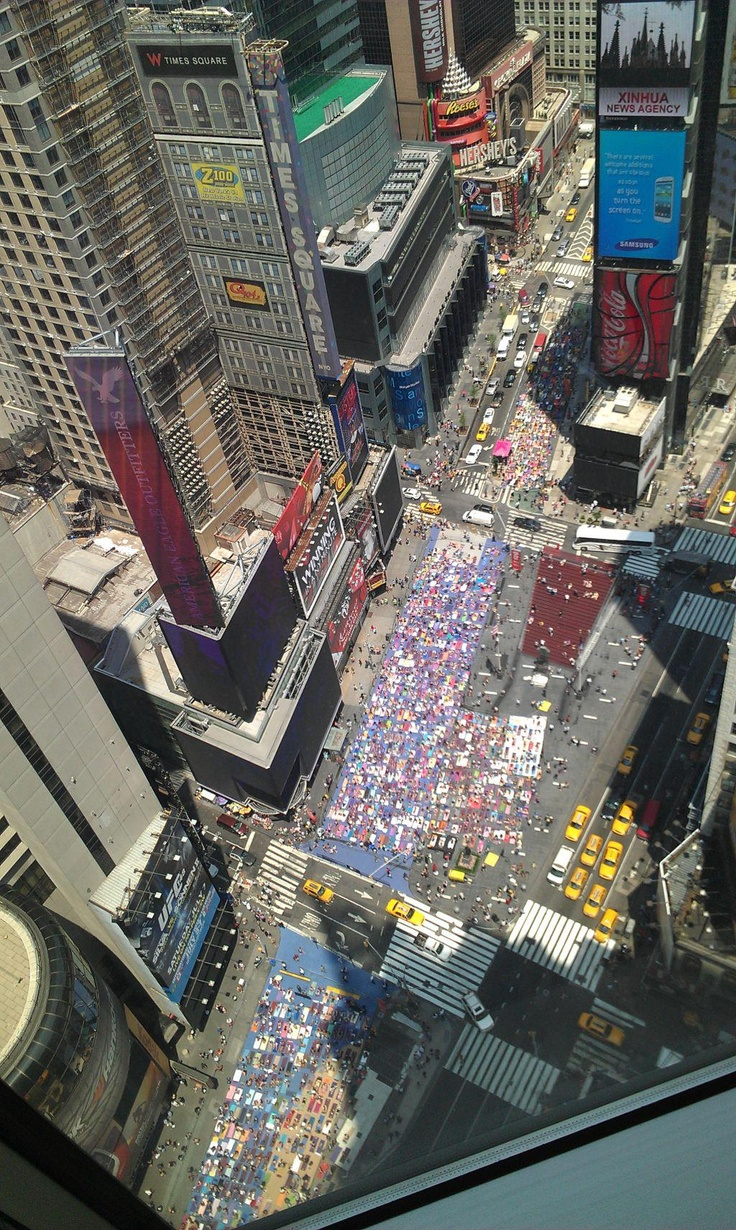 NYC. Thousands of people doing yoga at Times Square celebrating summer's solstice 20/6/2012