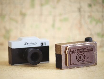 "Cute tiny camera shaped wood stamp that stamps a cute camera design. Stamp measures  1.75""x1"". Choose grey or brown camera."