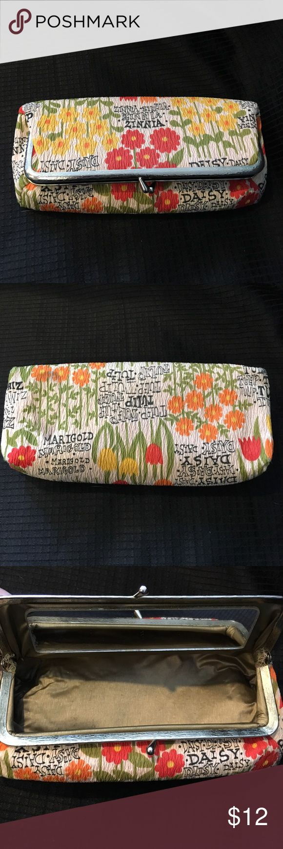 🍒 2 for $12 Mirrored Flower Makeup/Cosmetic Bag Mirrored Flower Makeup Bag. Mirror is in tacked. It snaps closed. There are flowers decorating the outside. Measures approx 8x4x3 inches. Please see last pic for stain on bottom. It's less noticeable in person. Unknown Bags Cosmetic Bags & Cases