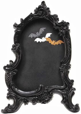 This Baroque chalkboard comes with three bat-shaped magnets. It stands 22 inches