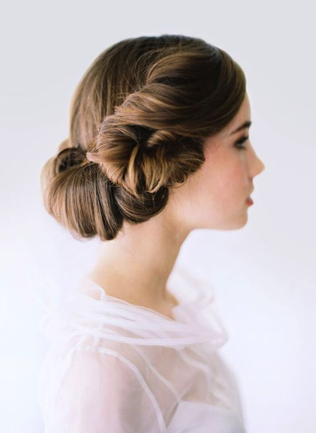 Swooning over this retro chignon-meets-victory-rolls style.