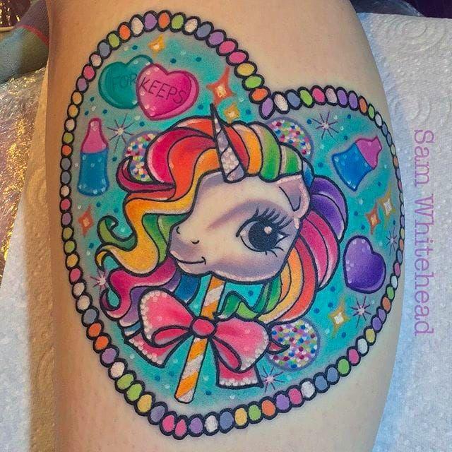 Unicorn lollipop and candies tattoo by Sam Whitehead via Instagram @Samwhiteheadtattoos samwhiteheadtattoos colorful girly girlytattoo neotraditional  blindeyetattoocompany Leeds UK unicorn lollipop candies