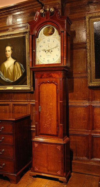 A fine early 19th Century longcase clock with oak case, inlaid with mahogany and satinwood, signed W Massey, Nantwich. William Massey of Nantwich, was a well known maker in the area. Born in Eccleshall, Staffordshire in 1783, the son of Lawrence Massey, also a Nantwich clock maker. Worked in the High Street from 1802 to 1850. He retired and was at Dysart Buildings in Nantwich from 1851 to 1861. He died 22 Jan 1862. Twin train movement of eight day duration with anchor escapement rack…
