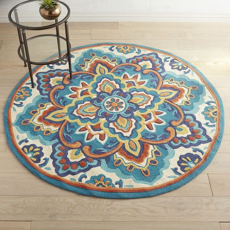Well, this is unexpected—an artistic medley of florals and a suggestion of the sun in a traditional round rug. Boldly bright and extremely soft, our rug deserves to be both admired and enjoyed. Consider your entryway or family room its gallery.