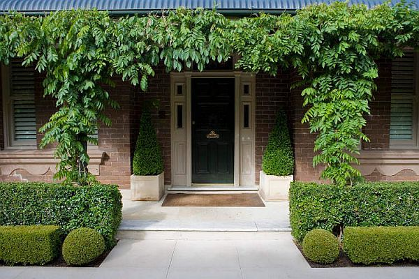 Lovely manicured entry by Australian landscape designer Paul Bangay