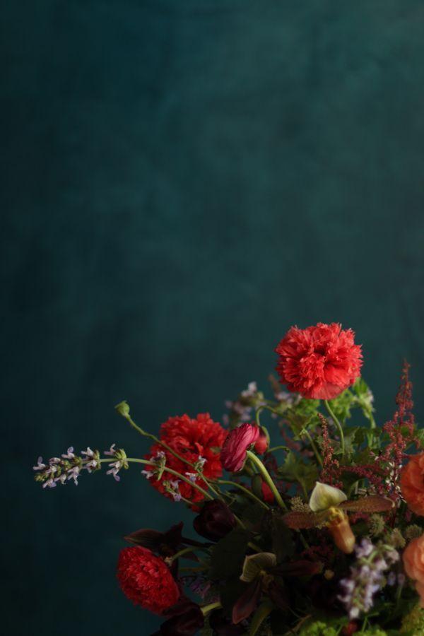 Dark teal wall with orange flwoers; Poppy Arrangement // The Nouveau Romantics // Austin Wedding Planning and Event Design Studio