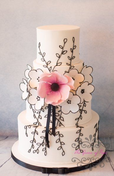 Stunning Floral Wedding Cake with black illustrated florals and a single pretty pink bloom