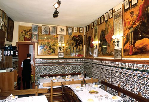 Madrid's Top 10 : El Rastro - Eating in El Rastro    There are many bars and cafés in the area. Malacatín at Calle Ruda 5 rustles up the delicious local stew cocido madrileño .