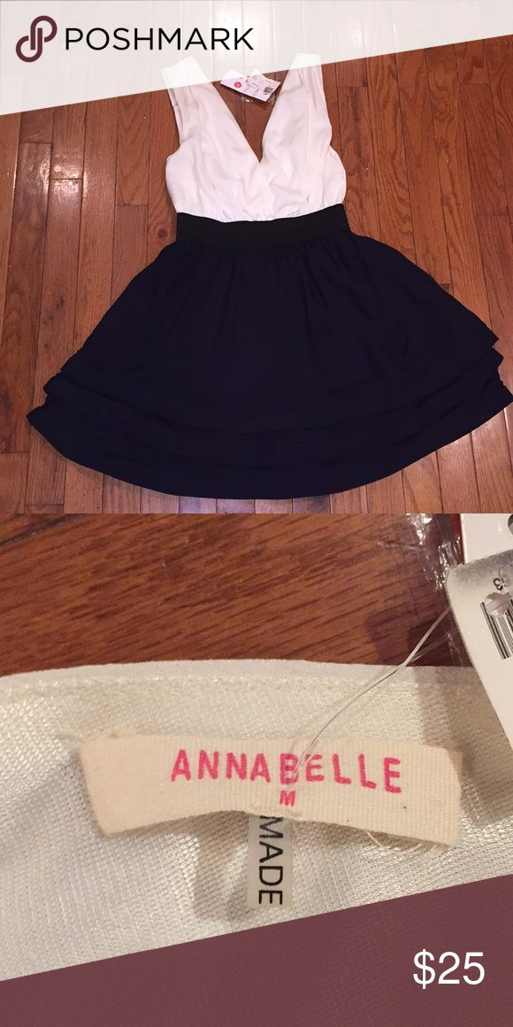 Annabelle cocktail dress Navy and cream cocktail dress that flares at the bottom. Never worn. New condition. Size medium. Annabelle (brand) from Lotus boutique. Paid $39.50 will take $25. Annabelle Dresses Midi