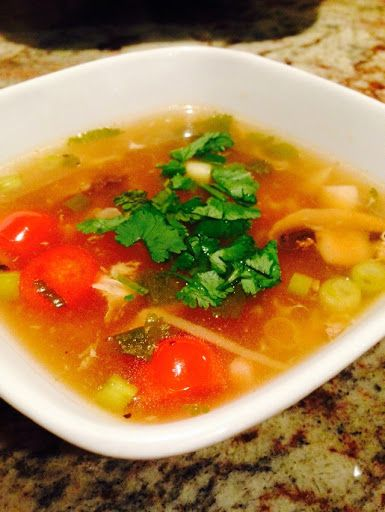 The Healing Hot And Sour Soup With Chicken Broth, Mushrooms, Tofu, Green Onions, Garlic, Ginger, Chopped Cilantro, Sugar, Corn Starch, Chili Powder, Salt, White Pepper, Soy Sauce, Rice Vinegar, Red Wine Vinegar, Lime, Sriracha Sauce, Eggs