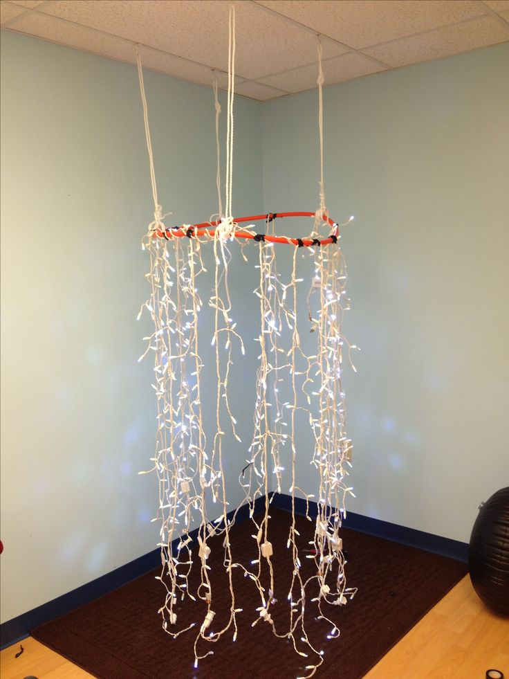 #sensory room light I made out of hula hoop, LED lights, vinyl tape, hooks and string. Needs some more reinforcement but exciting for now! will see how kiddos like it! Www.fiveminutefinemotor.blogspot.com