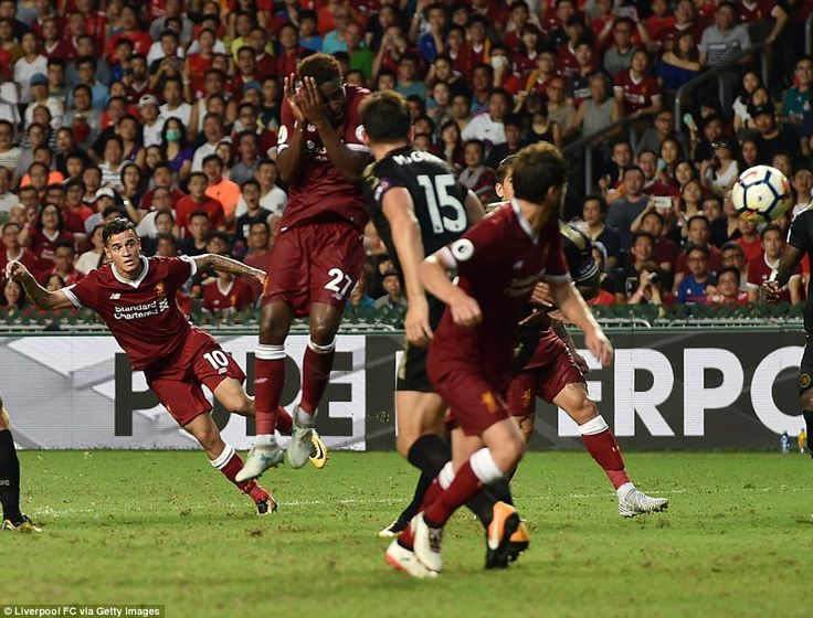 The midfielder watches as his fine strike beats Kasper Schmeichel and finds the back of the net to give Liverpool the lead