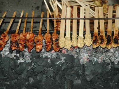 Beef, chicken or fish satay freshly cooked over charcoal at the Gianyar night market. JP/JB Djwan